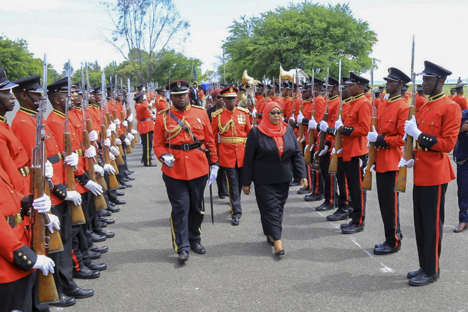 Tanzania's new president Samia Suluhu Hassan, center-right, inspects the guard of honor after being sworn in at a ceremony at State House in Dar es Salaam, Tanzania Friday, March 19, 2021. Samia Suluhu Hassan made history Friday when she was sworn in as Tanzania's first female president, following the death of her predecessor John Magufuli. (AP Photo)