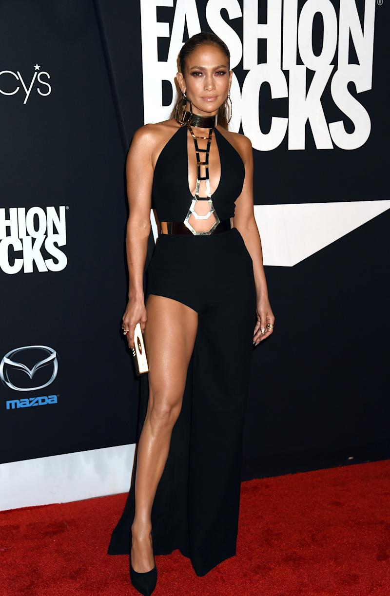 After a series of prototypically J. Lo, yet unsurprising, looks, this Versace gown is sleek, edgy, and chic. Jennifer Lopez in Versace at Fashion Rocks in New York, New York, September 2014. Photo by Jeff Kravitz/FilmMagic.