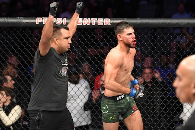 Yair Rodriguez celebrates with his coach Israel Martinez after knocking out Chan Sung Jung of South Korea during UFC Fight Night inside Pepsi Center on Nov. 10, 2018 in Denver, Colorado. (Getty Images)