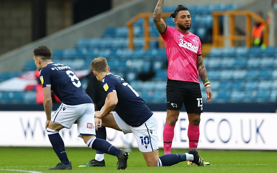 Millwall fans who booed Black Lives Matter protest condemned by Football Association - GETTY IMAGES