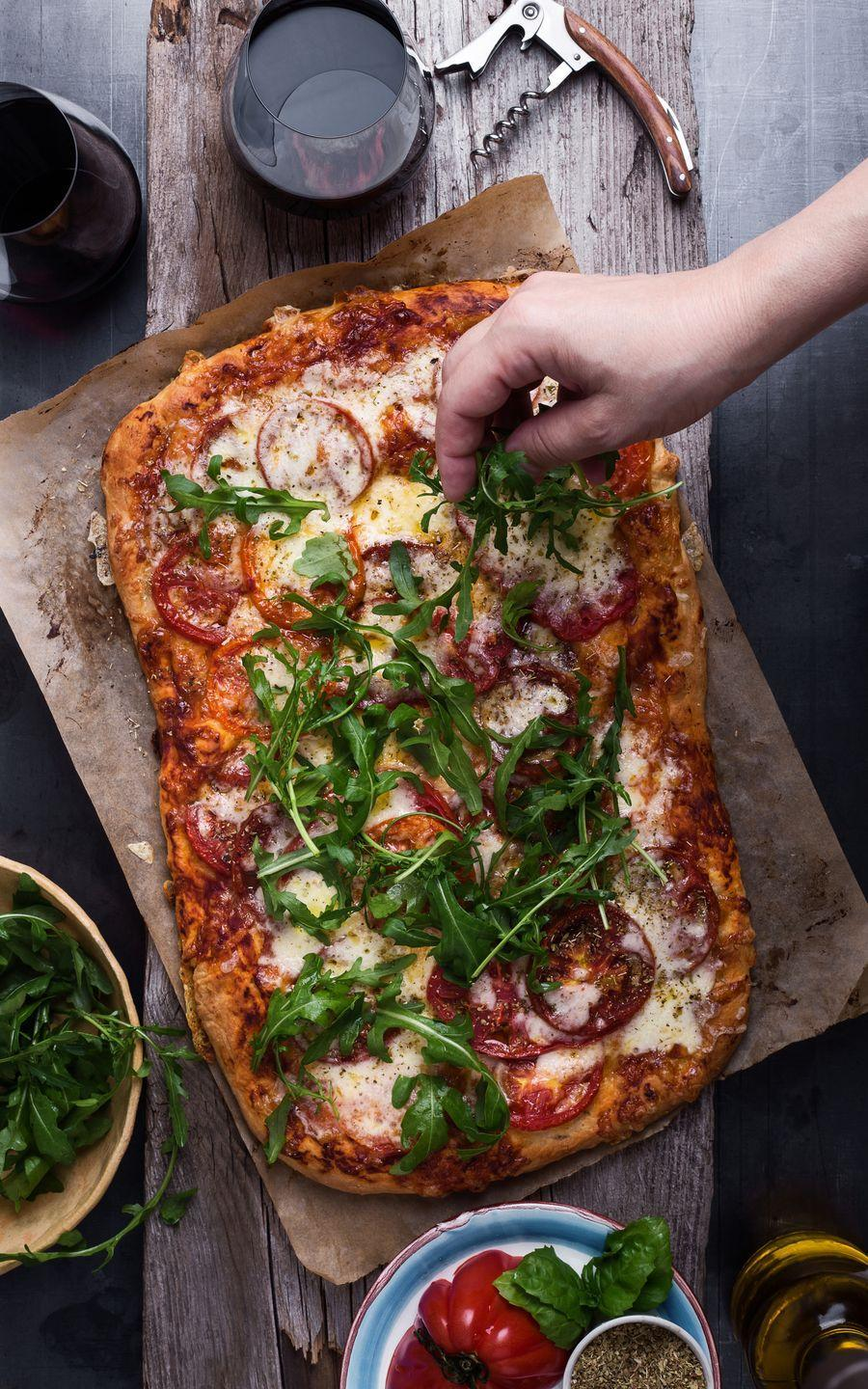 """<p>The best part about making your own pizzas is that you can go wild when it comes to toppings. No one can judge your Hawaiian pizza in the comfort of your home, right? Try this simple homemade <a href=""""https://www.countryliving.com/food-drinks/a27575518/pizza-dough-recipe/"""" rel=""""nofollow noopener"""" target=""""_blank"""" data-ylk=""""slk:pizza dough recipe"""" class=""""link rapid-noclick-resp"""">pizza dough recipe</a> for the perfect base.</p><p><a class=""""link rapid-noclick-resp"""" href=""""https://www.amazon.com/Unicook-Ceramic-Grilling-Resistant-Rectangular/dp/B06XGV3RS4/?tag=syn-yahoo-20&ascsubtag=%5Bartid%7C10050.g.30445302%5Bsrc%7Cyahoo-us"""" rel=""""nofollow noopener"""" target=""""_blank"""" data-ylk=""""slk:SHOP PIZZA STONES"""">SHOP PIZZA STONES</a></p>"""