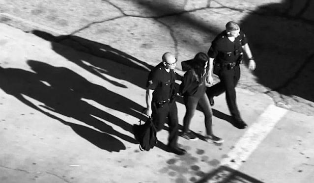 A student is led away by law enforcement officers after four students were injured in Thursday's shooting incident at Sal Castro Middle School in Los Angeles. (Photo: KTLA screenshot)