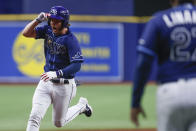 Tampa Bay Rays' Brett Phillips, left, circles the bases after hitting a three-run home run against the Detroit Tigers during the 10th inning of a baseball game Friday, Sept. 17, 2021, in St. Petersburg, Fla. (AP Photo/Scott Audette)