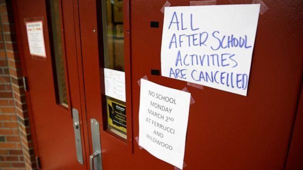 PHOTO: Signs announcing a closure and cancelled activities are pictured at Ferrucci Junior High School after two schools were closed for cleaning due to flu-like symptoms of a relative in Puyallup, Washington, March 2, 2020. (Jason Redmond/Reuters)