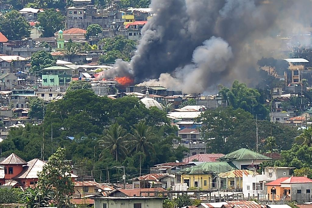 An assault on Marawi in the Philippines by fighters flying the IS flag has ignited an unprecedented urban war and claimed hundreds of lives (AFP Photo/Ted ALJIBE)