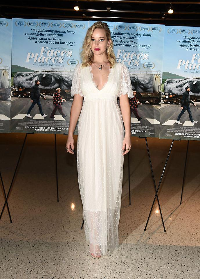 """<p><strong>When: Oct. 11, 2017 </strong><br />Jennifer Lawrence opted to wear a flowing white semi-sheer L. Wells Bridal gown at the premiere of """"Faces Places"""" in California on Wednesday night. The 27-year-old paired the angelic frock with messy beach waves, layered chains and a berry-red lip. She looked so divine that more than a few are wondering if a wedding is around the corner for her and <a rel=""""nofollow"""" href=""""https://ca.style.yahoo.com/celebrity/jennifer-lawrence-darren-aronofsky-take-romance-public-venice-film-festival-214241384.html"""">her beau, director Darren Aronofsky</a>. (<em>Photo: Getty</em>) </p>"""