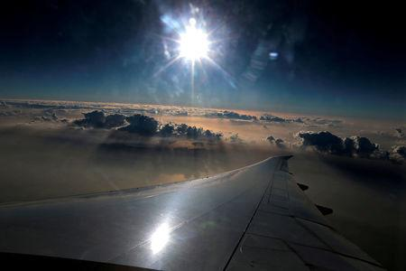 FILE PHOTO: The view from the window of an Emirates airlines flight en route to Islamabad, Pakistan January 8, 2018.  REUTERS/Caren Firouz