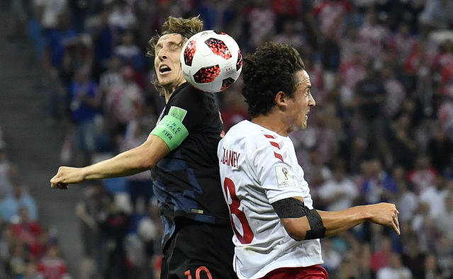 Croatia's Luka Modric, left, and Denmark's Thomas Delaney challenge for the ball during the round of 16 match between Croatia and Denmark at the 2018 soccer World Cup in the Nizhny Novgorod Stadium, in Nizhny Novgorod , Russia, Sunday, July 1, 2018. (AP Photo/Martin Meissner)