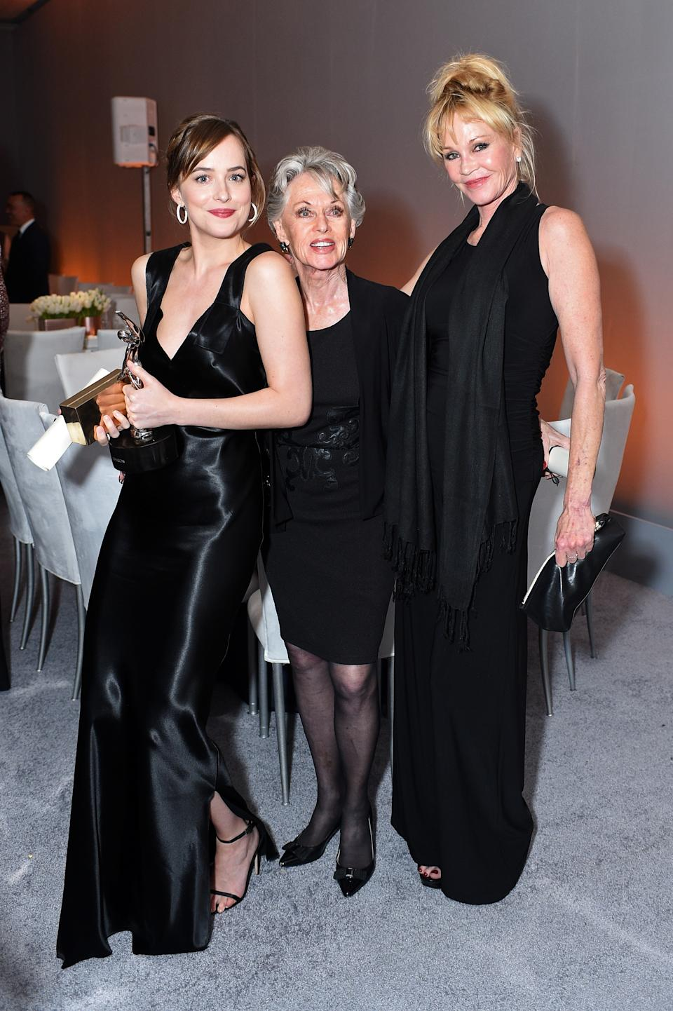 LOS ANGELES, CA - OCTOBER 19: (L-R) Actors Dakota Johnson, Tippi Hedren and Melanie Griffith pose with the Calvin Klein Emerging Star Award during the 22nd Annual ELLE Women in Hollywood Awards presented by Calvin Klein Collection, L'Oréal Paris, and David Yurman at the Four Seasons Los Angeles at Beverly Hills on October 19, 2015 in Beverly Hills, California.  (Photo by Stefanie Keenan/Getty Images for ELLE)