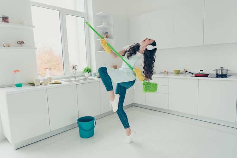 Full length body size portrait of her she nice adorable beautiful cheerful wavy-haired house-wife using broom dancing having fun in modern light white interior indoors