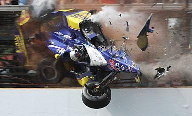 Mike Conway, of England, crashes into the fencing in the third turn during the closing laps of the Indianapolis 500