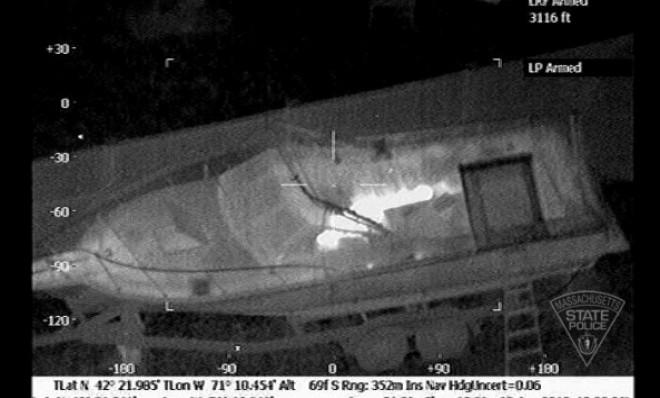 The boat in which Boston Marathon bombing suspect Dzhokhar Tsarnaev hid is seen from the Forward Looking Infrared setting of a police helicopter on April 19.