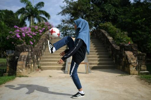 She trains four to five days a week, balancing, kicking and juggling the ball for up to three hours in every session