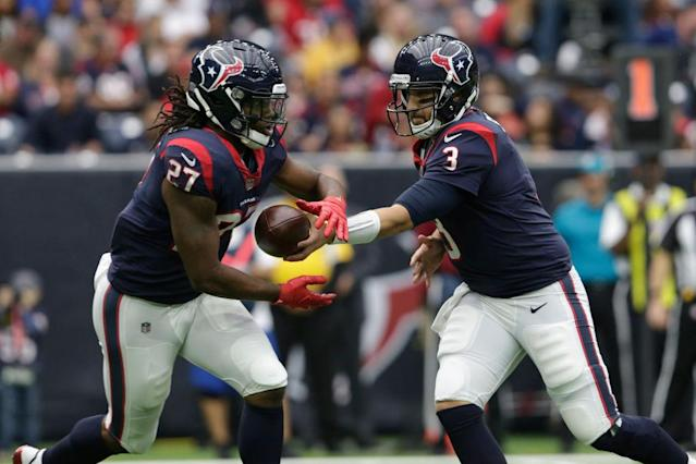 D'Onta Foreman takes the handoff from QB Tom Savage. (Getty)