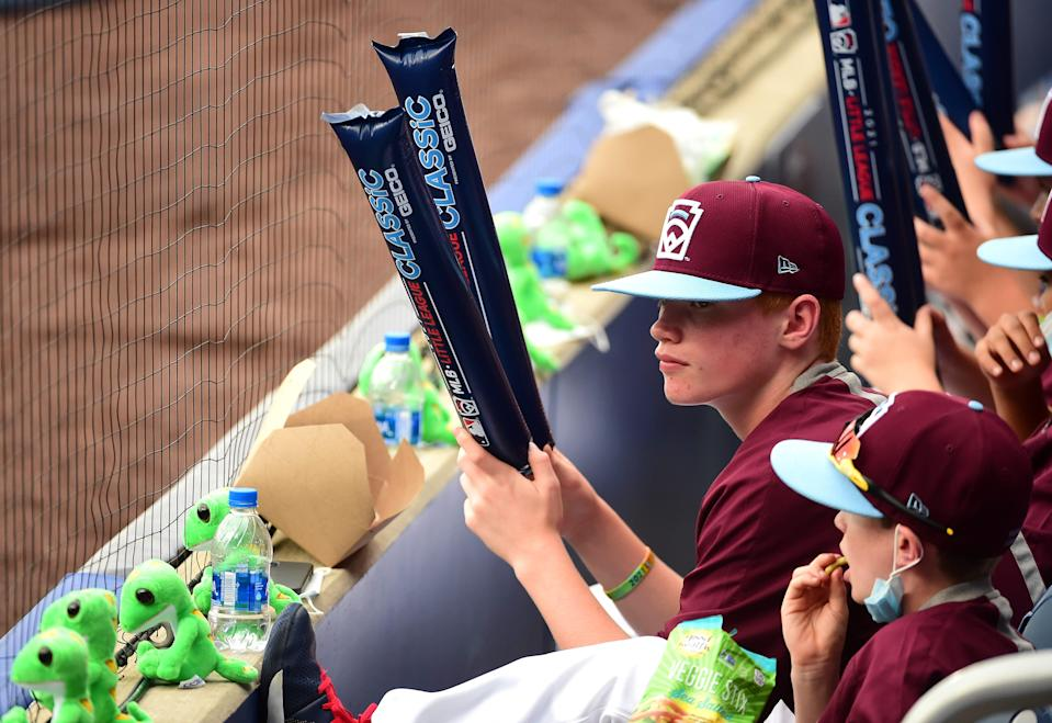 Little League players sit in the stands prior to the game between the Los Angeles Angels and Cleveland at BB&T Ballpark at Historic Bowman Field.