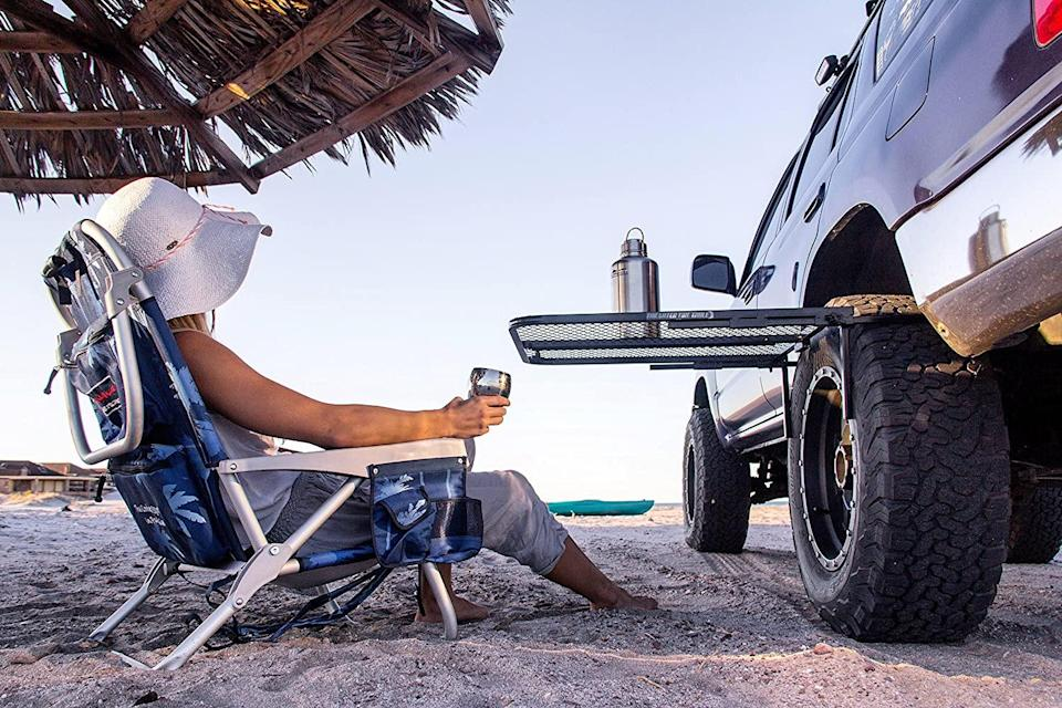 "<h3>Attachable Tire Table</h3> <br>There are a lot of portable tables out there, but the Tire Table wowed us with its sturdy, simple, and sensible design. ""This little table is neat,"" said an Amazon reviewer. ""I love the easy setup and the option to use on any tire. My main use is serving as a stand for my grill when camping but I can see myself using it as a table when traveling along the side of the road or rest stop for lunch. Put my awing out on my RV and I have my own oasis. Well made. I love the push connections and flat storage. This is a good little table at a fair price.""<br><br><strong>Tire Table</strong> Steel Table, $, available at <a href=""https://www.amazon.com/TailGater-Tire-Table-Vehicle-Tire-Mounted/dp/B06Y1GRNWG"" rel=""nofollow noopener"" target=""_blank"" data-ylk=""slk:Amazon"" class=""link rapid-noclick-resp"">Amazon</a><br>"