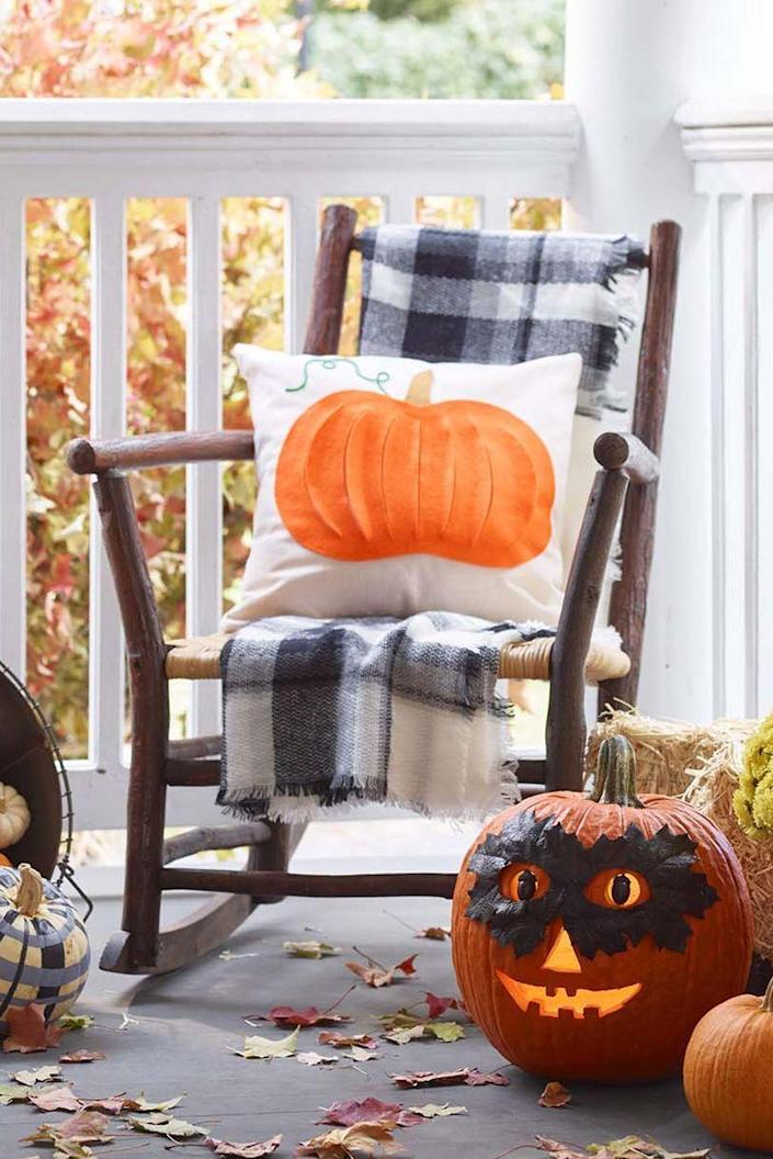 """<p>Deck out your porch with freshly-picked pumpkins that are as cozy as they come — and a no-sew pillow to match.</p><p><em><strong><a href=""""https://www.womansday.com/home/crafts-projects/g22840971/halloween-2018-templates/"""" rel=""""nofollow noopener"""" target=""""_blank"""" data-ylk=""""slk:Get the Plush Pumpkin Pillow template."""" class=""""link rapid-noclick-resp"""">Get the Plush Pumpkin Pillow template.</a></strong></em></p>"""