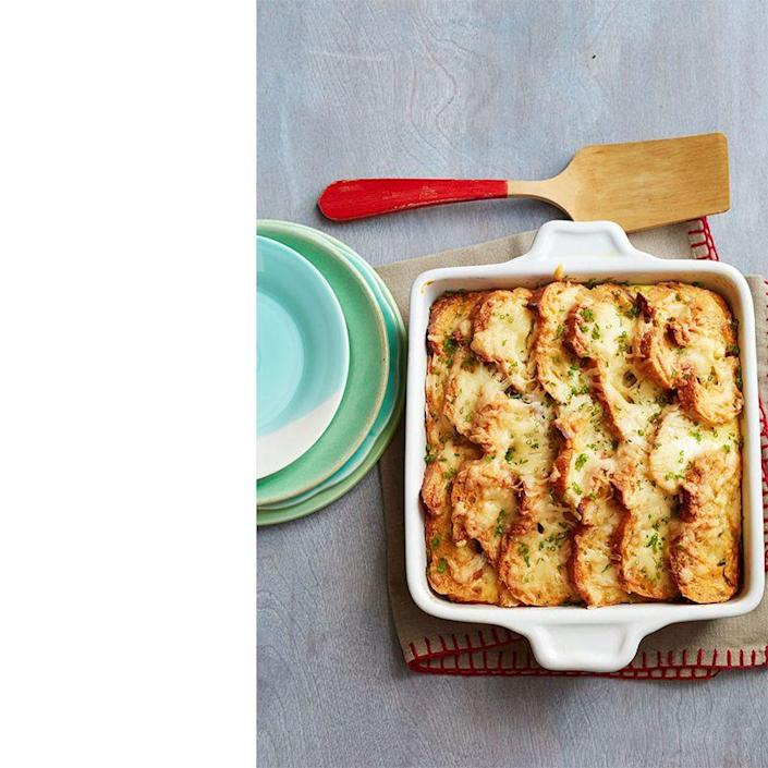 """<p>Eggs, cheese and ham — what more could a man possibly want?! After assembling the ingredients in a baking dish, slide it into the oven for an easy, delicious meal.</p><p><a href=""""https://www.womansday.com/food-recipes/food-drinks/recipes/a40005/ham-cheese-breakfast-bake-recipe-ghk0914/"""" rel=""""nofollow noopener"""" target=""""_blank"""" data-ylk=""""slk:Get the Ham and Cheese Breakfast Bake recipe."""" class=""""link rapid-noclick-resp""""><em>Get the Ham and Cheese Breakfast Bake recipe.</em></a></p>"""