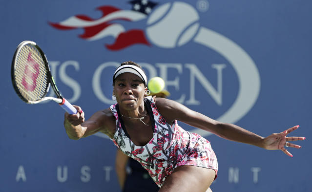 Venus Williams returns a shot to Bethanie Mattek-Sands during the first round of play at the 2012 US Open tennis tournament, Tuesday, Aug. 28, 2012, in New York. (AP Photo/Charles Krupa)