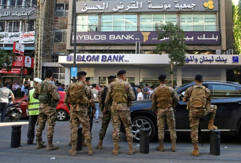 Lebanese troops surround protesters demonstrating outside a bank in Lebanon  on November 4