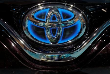 The Toyota logo is seen on the bonnet of a newly launched Camry Hybrid electric vehicle at a hotel in New Delhi