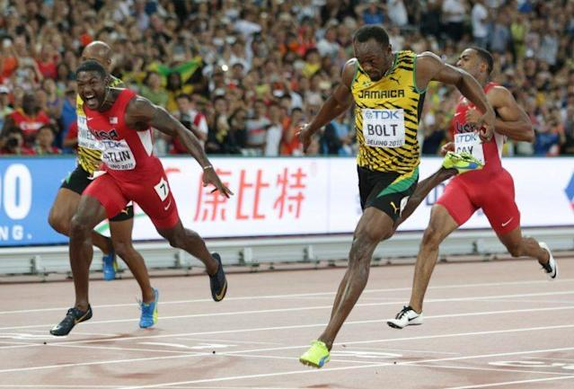 Jamaica's Usain Bolt (right) wins the gold medal in the men's 100-meter ahead of United States' Justin Gatlin (left) at the World Athletics Championships at the Bird's Nest stadium in Beijing. (AP)