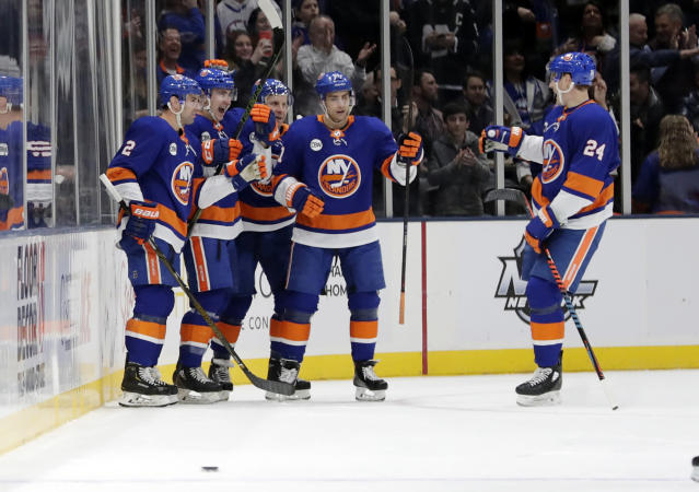 New York Islanders' Nick Leddy (2) and Scott Mayfield (24) celebrate with teammates after Michael Dal Colle scored a goal during the first period of an NHL hockey game against the New Jersey Devils, Thursday, Jan. 17, 2019, in Uniondale, N.Y. (AP Photo/Frank Franklin II)
