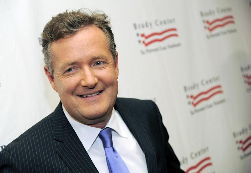 "FILE - This May 7, 2013 file photo shows Piers Morgan at the Brady Campaign to Prevent Gun Violence Los Angeles Gala in Beverly Hills, Calif. ""  Morgan has a deal with Gallery Books for ""Shooting Straight: Guns, Gays, God, and George Clooney."" Gallery, an imprint of Simon & Schuster, announced Wednesday, May 22, that the book is scheduled for October.  (Photo by Chris Pizzello/Invision/AP, file)"