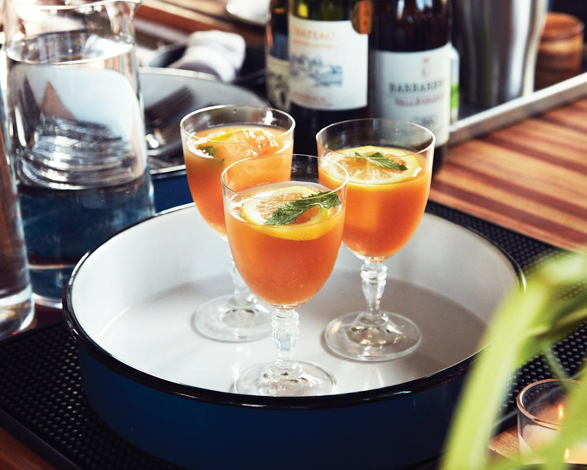 """This spiked fruit tea is intentionally not too boozy, but you can also just leave the bourbon out. <a href=""""https://www.epicurious.com/recipes/food/views/bourbon-whiskey-fruit-tea-punch?mbid=synd_yahoo_rss"""">See recipe.</a>"""
