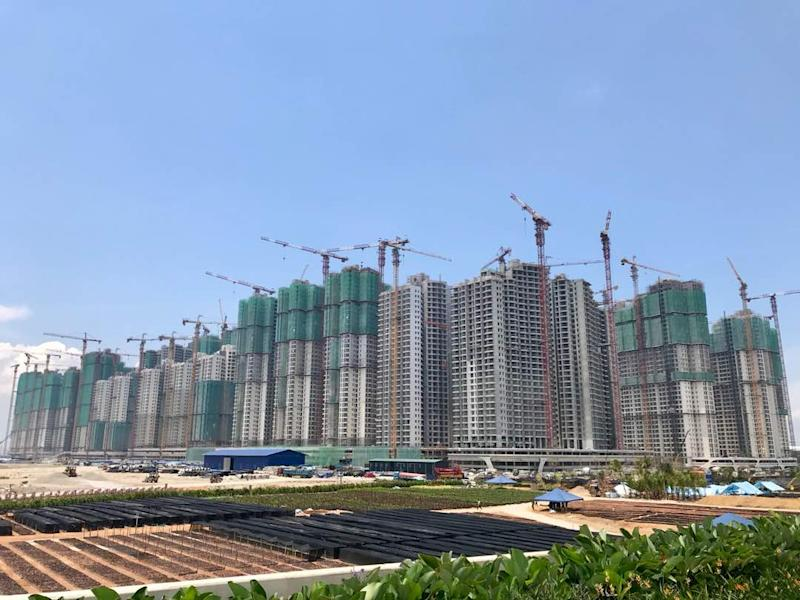 Part of Forest City's soon-to-be completed apartment and commercial high-rise buildings overlooking the first island. — Picture by Ben Tan