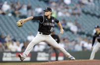 Colorado Rockies starting pitcher Kyle Freeland works against the Seattle Mariners during the first inning of a baseball game, Tuesday, June 22, 2021, in Seattle. (AP Photo/John Froschauer)