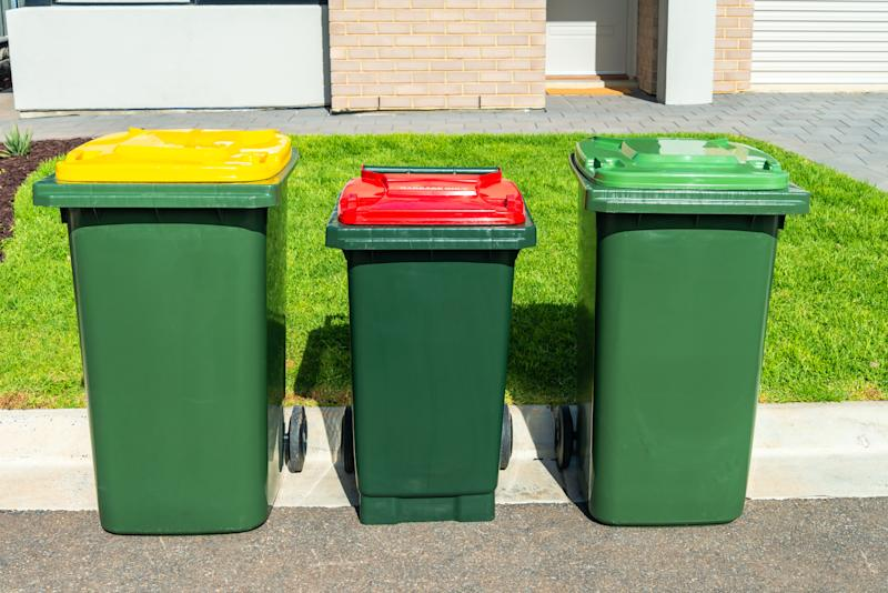 Australian wheelie bins with colourful lids for organic, general waste, and recycling products provided by local city council
