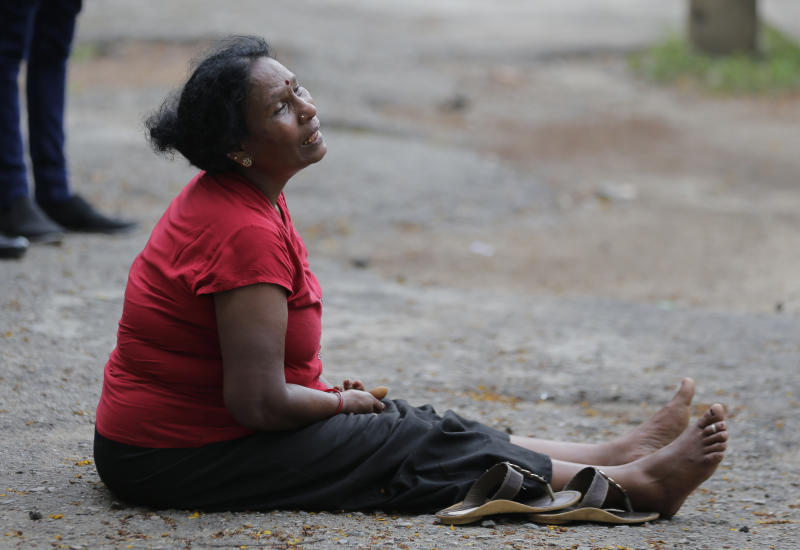 A relative of a blast victim grieves outside a morgue in Colombo, Sri Lanka, Sunday, April 21, 2019.  More than hundred were killed and hundreds more hospitalized with injuries from eight blasts that rocked churches and hotels in and just outside of Sri Lanka's capital on Easter Sunday, officials said, the worst violence to hit the South Asian country since its civil war ended a decade ago. (AP Photo/Eranga Jayawardena)