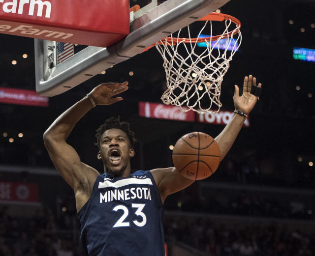 "Despite what it may seem like, <a class=""link rapid-noclick-resp"" href=""/nba/players/4912/"" data-ylk=""slk:Jimmy Butler"">Jimmy Butler</a> is not yawning from exhaustion here. (AP)"