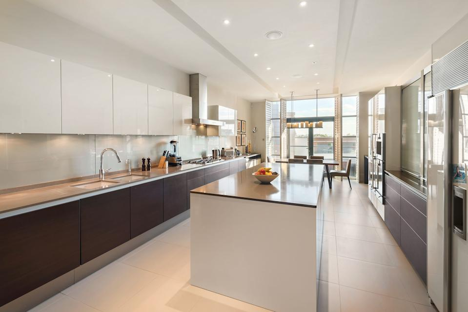 The kitchen in the duplex apartment in Knightsbridge's Trevor Square. Photo: Lawrie Cornish