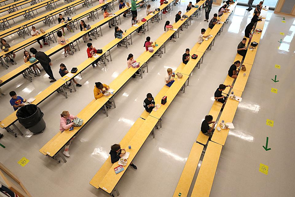 MILFORD, MA - SEPTEMBER 11: School children are spaced apart in one of the rooms used for lunch at Woodland Elementary School in Milford, MA on Sept. 11, 2020. (Photo by Suzanne Kreiter/The Boston Globe via Getty Images)
