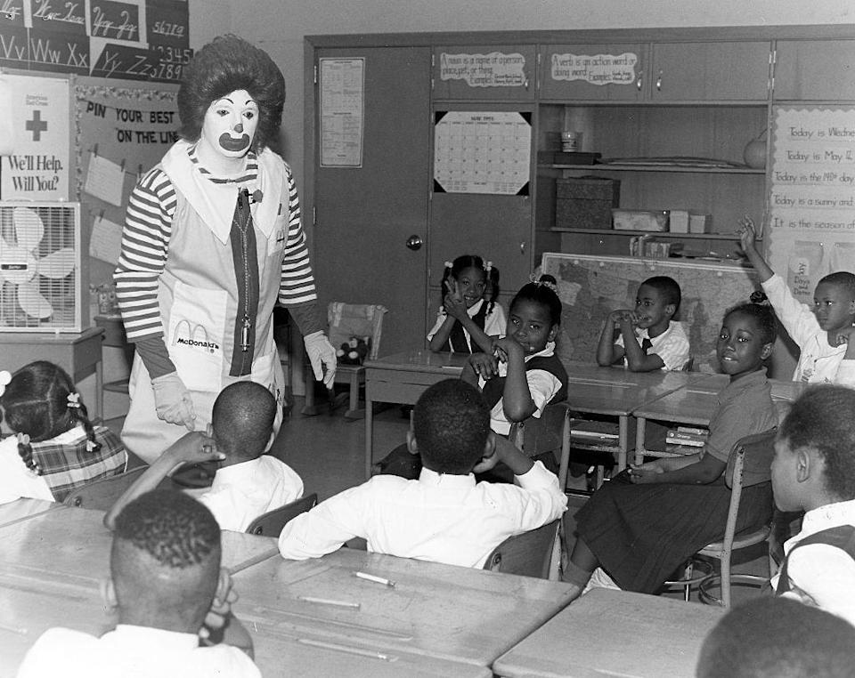 "<p>Largely inspired by Bozo the Clown, the character of Ronald McDonald first appeared in advertisements on TV in 1963. The brand ambassador's full moniker was ""Ronald McDonald, the Hamburger-Happy Clown."" Here, an actor gives a second grade class at Grove Park Elementary School a fire safety lesson.<br></p>"