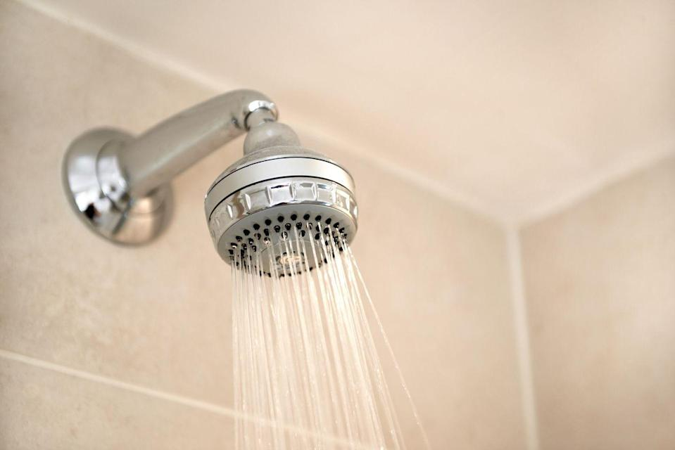 "<p>A clogged showerhead impacts your water pressure, which results in a less-efficient shower that can cause you to run out of hot water quicker (not fun in the winter!). ""Use a sturdy plastic bag large enough to fit over the showerhead,"" says Bidwell. ""Place the bag around the showerhead and fill it with white or apple cider vinegar while holding it in place. Allow the head to soak in the vinegar for at least 12 hours. If it's brass, gold or nickel-coated showerheads, be sure to only soak for 30 minutes. After the showerhead has soaked, remove the bag and pour the vinegar down the drain. Turn on the shower and run hot water through the head to remove any loose mineral deposits. Use a toothpick and an old toothbrush to scrub the water ports and knock off any stuck-on buildup.</p>"