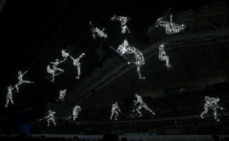 Lit figures are seen during the opening ceremony of the 2014 Sochi Winter Olympics, February 7, 2014. REUTERS/Jim Young