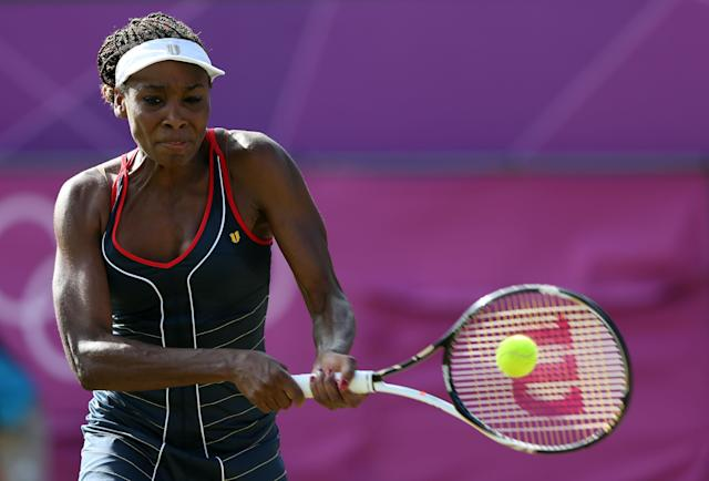 LONDON, ENGLAND - AUGUST 01: Venus Williams of the United States returns the ball to Angelique Kerber of Germany during the third round of Women's Singles Tennis on Day 5 of the London 2012 Olympic Games at Wimbledon on August 1, 2012 in London, England. (Photo by Clive Brunskill/Getty Images)
