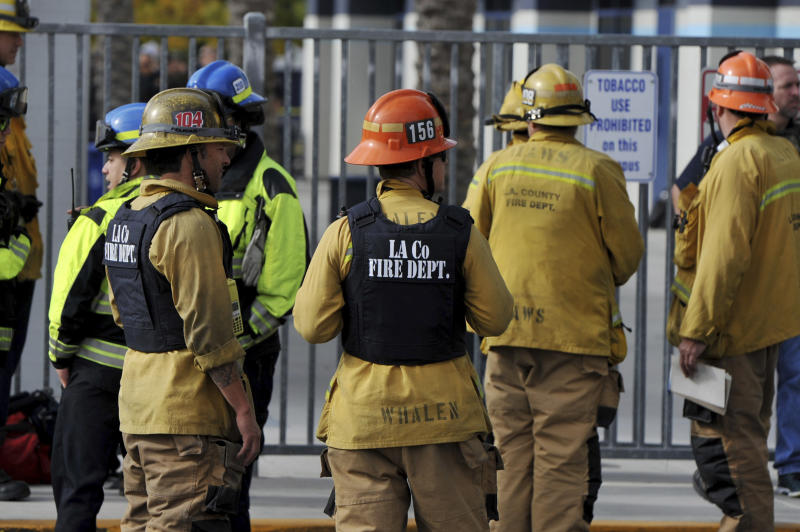 First responders standby for any injured students after a gunman opened fire at Saugus High School, Nov. 14, 2019, in Santa Clarita, Calif. (Photo: Christian Monterrosa/AP)