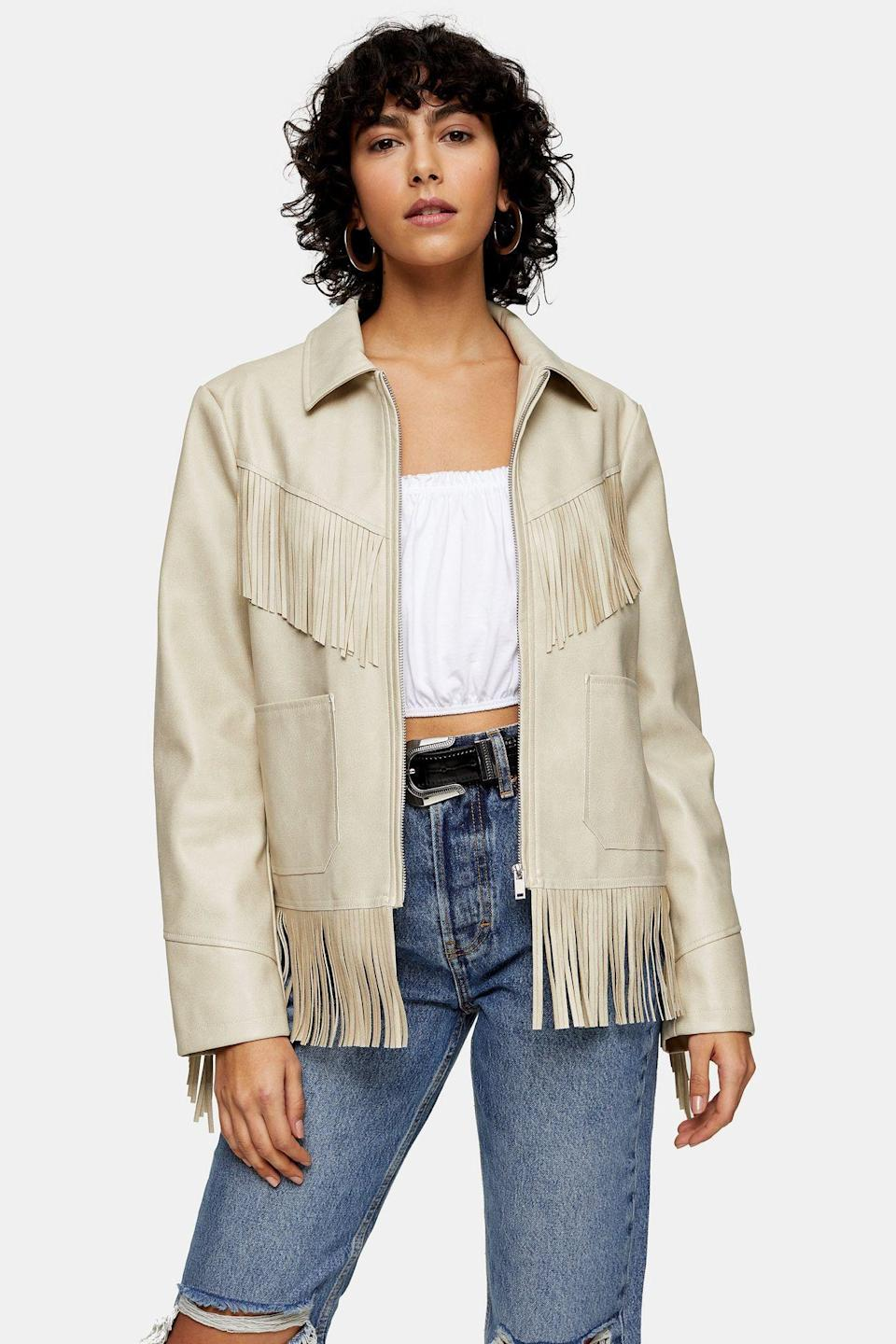 """<p><strong>Topshop</strong></p><p>topshop.com</p><p><strong>$110.00</strong></p><p><a href=""""https://go.redirectingat.com?id=74968X1596630&url=https%3A%2F%2Fus.topshop.com%2Fen%2Ftsus%2Fproduct%2Fecru-faux-leather-fringe-jacket-9772410&sref=https%3A%2F%2Fwww.cosmopolitan.com%2Fstyle-beauty%2Ffashion%2Fg30933395%2Ffall-fashion-trends-2020%2F"""" rel=""""nofollow noopener"""" target=""""_blank"""" data-ylk=""""slk:Shop Now"""" class=""""link rapid-noclick-resp"""">Shop Now</a></p><p>It really doesn't matter what else you're wearing when you have a fringe jacket like this one.</p>"""