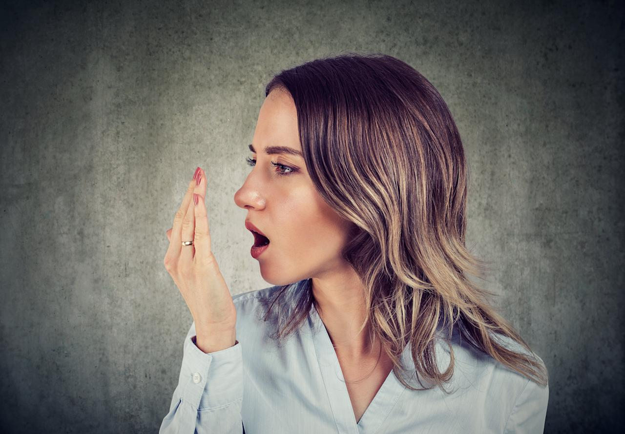 """<p>Having bad breath is kind of like getting toilet paper stuck to the bottom of your foot: usually harmless, but so awkward that nobody will tell you about it. At the microbial level, bad breath happens when the naturally occurring <a href=""""http://jada.ada.org/article/S0002-8177(14)61845-6/pdf"""" target=""""_blank"""">bacteria in our mouths</a> break down the food particles that are lingering in between <a href=""""/health/gallery/0,,20398266,00.html"""">our teeth</a>, along our gum lines, and, especially, on our tongue. This process releases a bunch of stinky compounds and gives rise to the dreaded <a href=""""http://www.nature.com/ijos/journal/v4/n2/full/ijos201239a.html"""" target=""""_blank"""">bad breath</a>—or, as it's more formally called, halitosis.</p> <p> The good news: It's is usually temporary. The bad news? It's often caused by a less-than-stellar brushing and flossing routine—as well as a bunch of other foods and habits too. Here are 17 reasons why your breath smells bad.</p> <p><strong>RELATED: <a href=""""https://www.health.com/oral-health/drinks-bad-breath"""">3 Drinks That Will Make Your Breath Reek</a></strong></p>"""