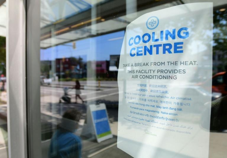 A welcoming sign is seen on the door of the Hillcrest Community Centre, where people can cool off during the extreme hot weather in Vancouver, British Columbia, Canada