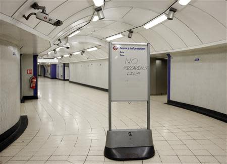 """A service information board states """"No Piccadilly Line"""" tube trains during strikes at Kings Cross underground station in London February 6, 2014. REUTERS/Olivia Harris"""