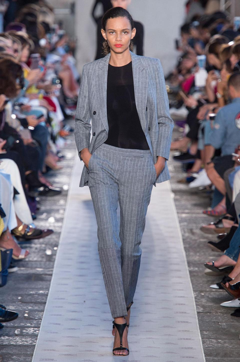 <p>Grey suit with black shirt from the SS18 Max Mara collection. (Photo: ImaxTree) </p>