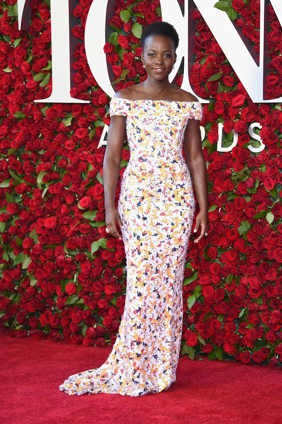 <p>Lupita Nyong'o's character in <i>Eclipsed</i>, for which she was nominated for a Tony for Best Actress, wears sweaty rags onstage, but the actress cleaned up for the red carpet in a floral gown custom designed by Jason Wu for Hugo Boss. <i>(Photo: Getty Images)</i></p>