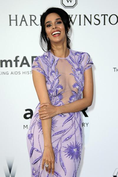 FILE - In this May 19, 2016 file photo, actress Mallika Sherawat poses for photographers upon arrival at the amfAR Cinema Against AIDS benefit at the Hotel du Cap-Eden-Roc, during the 69th Cannes international film festival, in Cap d'Antibes, southern France. The Paris prosecutor's office says Bollywood actress Mallika Sherawat and partner Cyrille Auxenfans were the targets of a botched robbery attempt involving tear gas in a posh area of the French capital. (AP Photo/Joel Ryan, File)