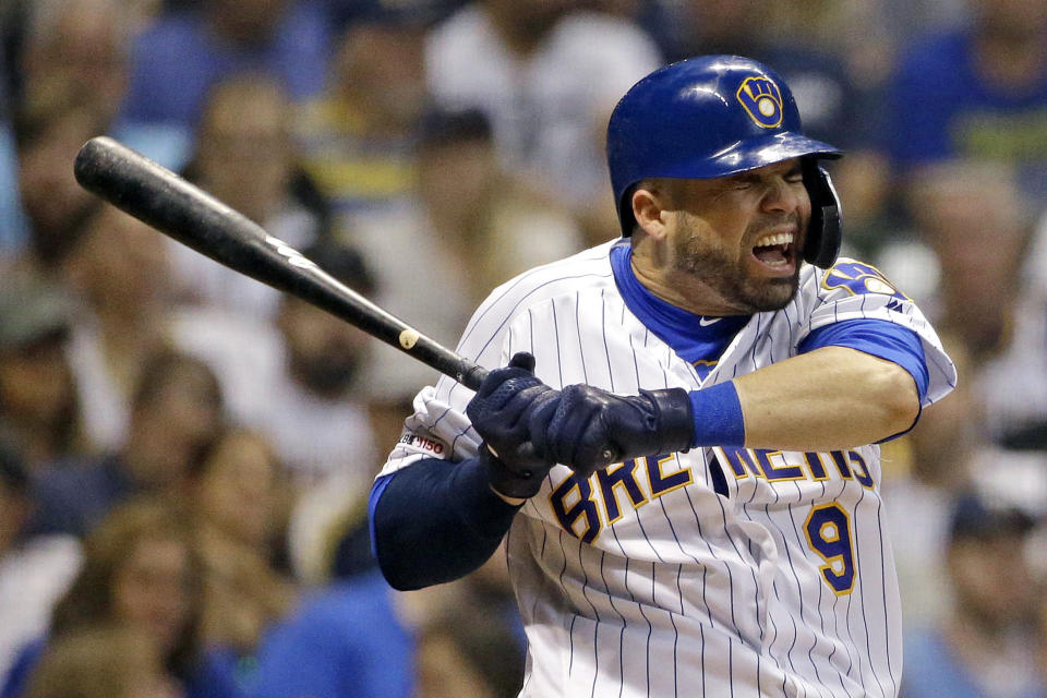 Milwaukee Brewers' Manny Pina reacts after being hit by a pitch during the sixth inning of the team's baseball game against the Pittsburgh Pirates on Friday, Sept. 20, 2019, in Milwaukee. (AP Photo/Aaron Gash)
