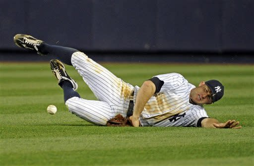 New York Yankees centerfielder Brett Gardner cannot catch a ball hit for a single by Houston Astros' Jose Altuve during the seventh inning of a baseball game Monday, April 29, 2013, at Yankee Stadium in New York. (AP Photo/Bill Kostroun)